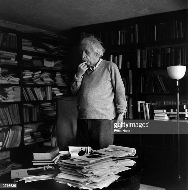 Premium Rates Apply German born physicist who formulated the theories of relativity Albert Einstein ponders a problem in his paperfilled study in...