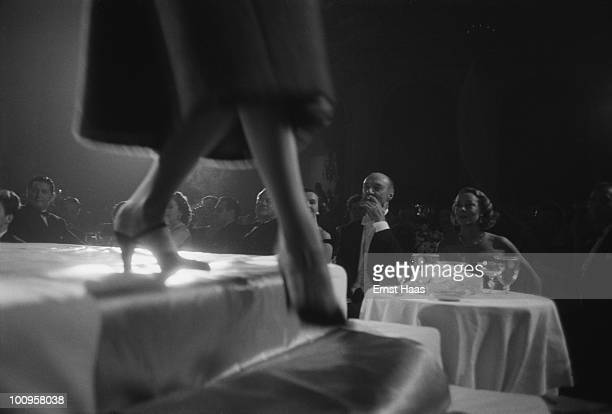 Premium Rates Apply Guests watching a fashion show at a ball held at the Plaza Hotel New York 1956