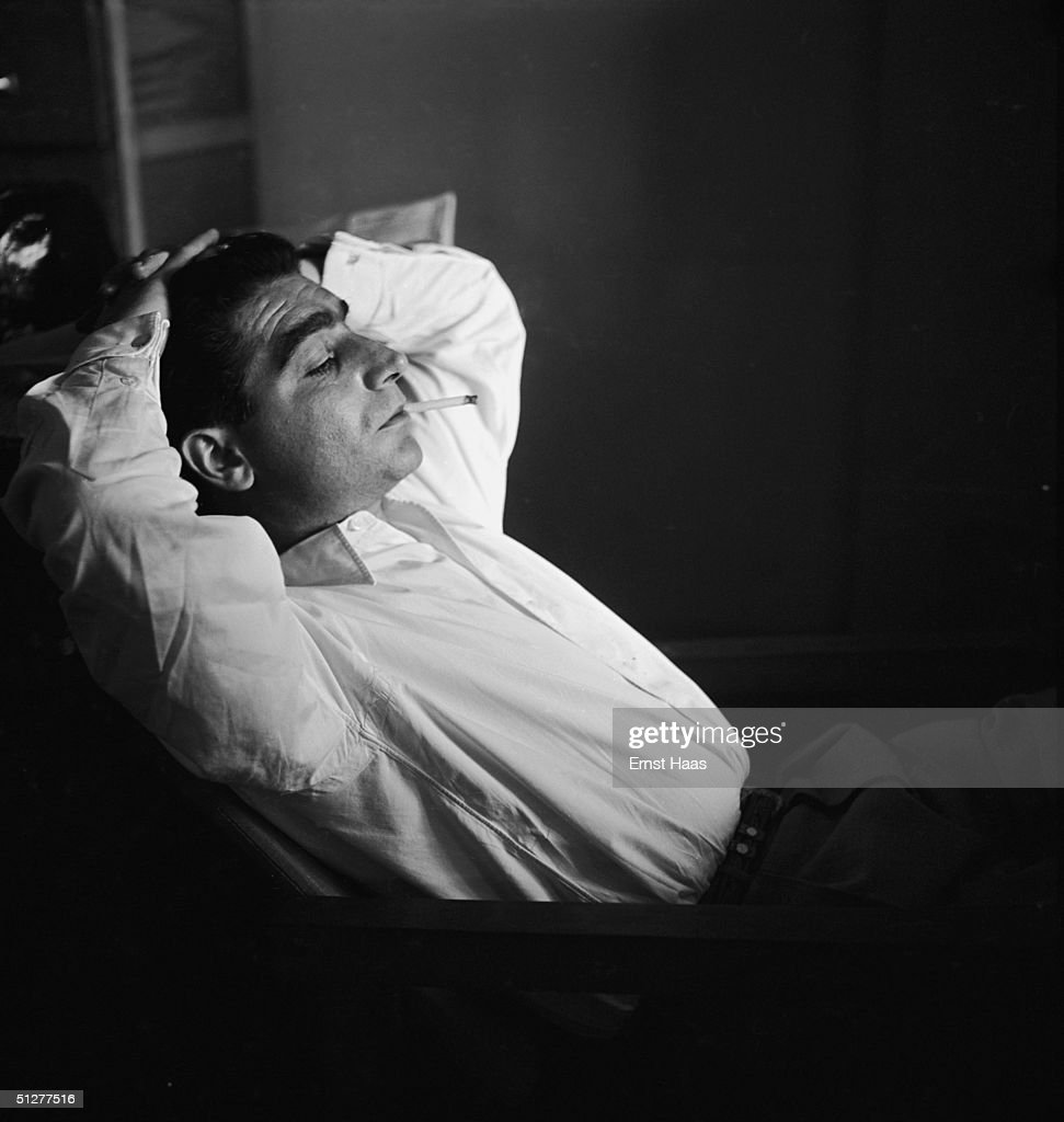 Premium Rates Apply. Hungarian-born photojournalist Robert Capa (1913 - 1954) at a meeting of the Magnum photographic co-operative, Paris, circa 1947.