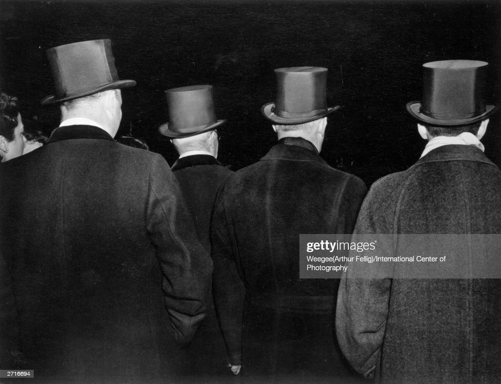 Premium Rates Apply. **NOT TO BE USED FOR POSTCARDS** The opera opened last night at the New York Metropolitan Opera, and a group of smart gentlemen arrive for the next performance. (Photo by Weegee (Arthur Fellig)/International Center of Photography/Getty Images)