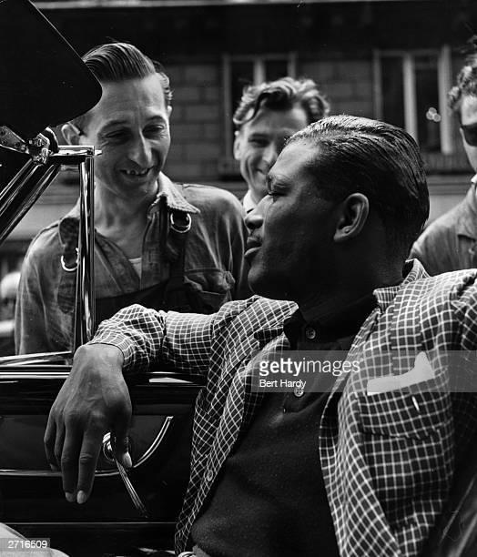 Premium Rates Apply Passersby speak to US boxer Sugar Ray Robinson in his car in Paris Original Publication Picture Post 5350 Sugar Ray pub 1951