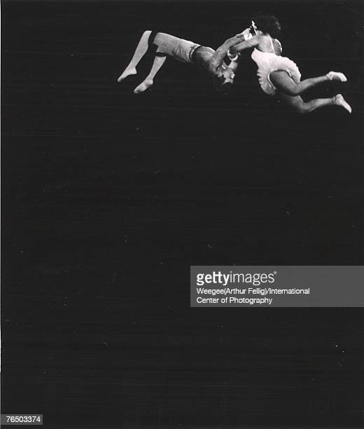 Premium Rates Apply Two aerialists perform in a circus 1940s or 1950s Photo by Weegee/International Center of Photography/Getty Images