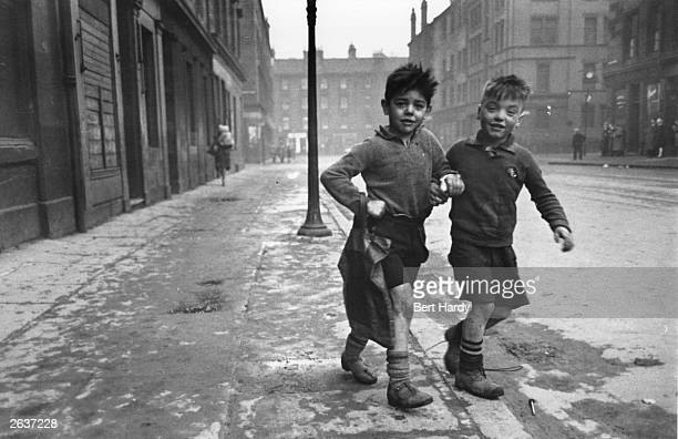 Premium Rates Apply Two boys in the Gorbals area of Glasgow The Gorbals tenements were built quickly and cheaply in the 1840s providing housing for...