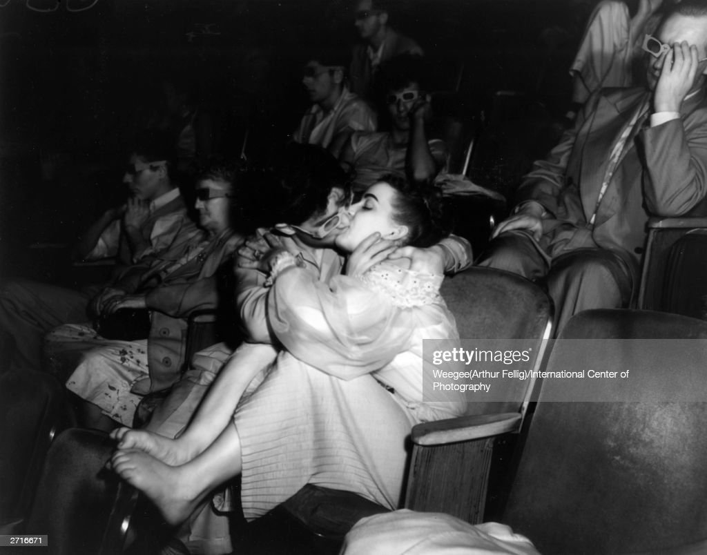 Premium Rates Apply. Two lovers at the Palace Theatre kissing in the front row. Original Artwork: Taken with infrared negative. (Photo by Weegee (Arthur Fellig)/International Center of Photography/Getty Images)