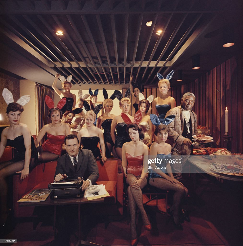 Premium Rates Apply. Working at his typewriter surrounded by 'bunny girls', publisher Hugh M Hefner at the Playboy Key Club in Chicago. He founded adult magazines, Playboy, VIp and Oui.