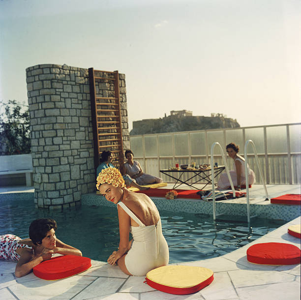 Young women by the Canellopoulos penthouse pool, Athens,...