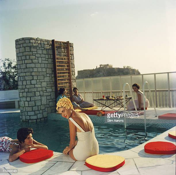 Premium Rates Apply Young women by the Canellopoulos penthouse pool Athens July 1961