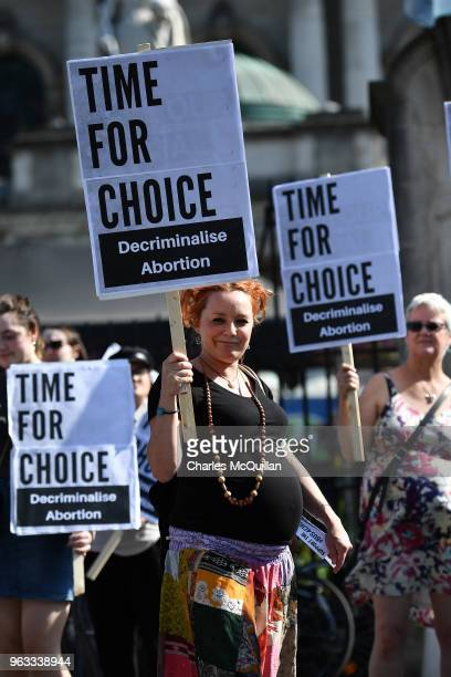 A prenant woman takes part in the campaign group Solidarity with Repeal as it holds a rally calling for abortion rights outside Belfast City Hall on...
