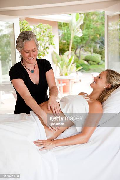 prenatal (pregnancy) massage - midwife stock pictures, royalty-free photos & images