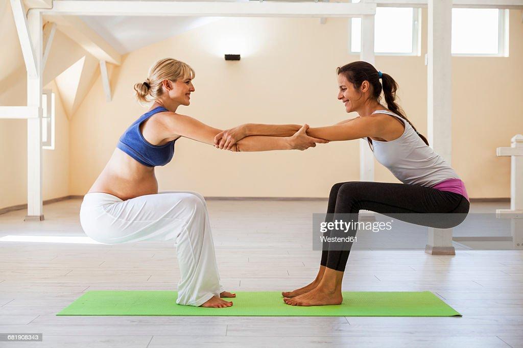 Prenatal Yoga Female Yoga Instructor Stretching Stock Photo Getty
