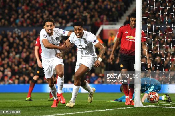 Prenel Kimpembe of PSG celebrates after he scores his sides first goal during the UEFA Champions League Round of 16 First Leg match between...