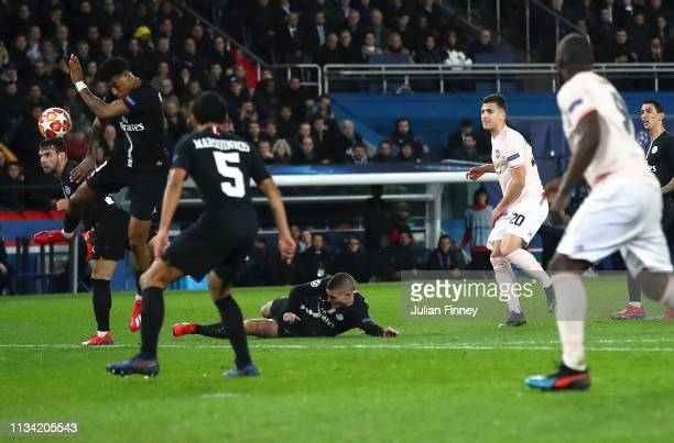 Prenel Kimpembe of PSG handles the ball inside the area from Diogo Dalot of Manchester United shot leading to a penalty via VAR during the UEFA...