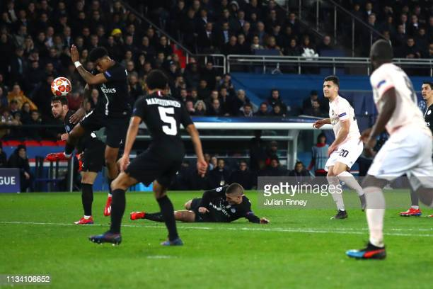 Prenel Kimpembe of PSG handles the ball inside the area leading to a penalty to Manchester United during the UEFA Champions League Round of 16 Second...