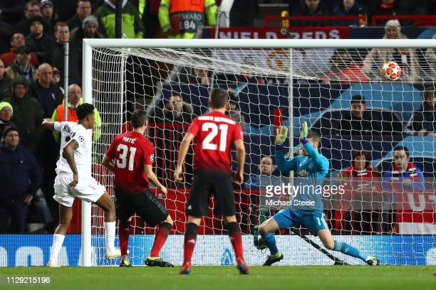 Prenel Kimpembe of PSG scores his sides first goal during the UEFA Champions League Round of 16 First Leg match between Manchester United and Paris...