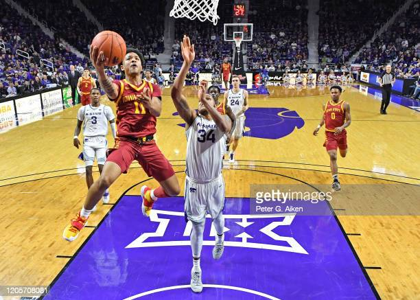 Prentiss Nixon of the Iowa State Cyclones drives in for a lay up against Levi Stockard III of the Kansas State Wildcats during the second half at...