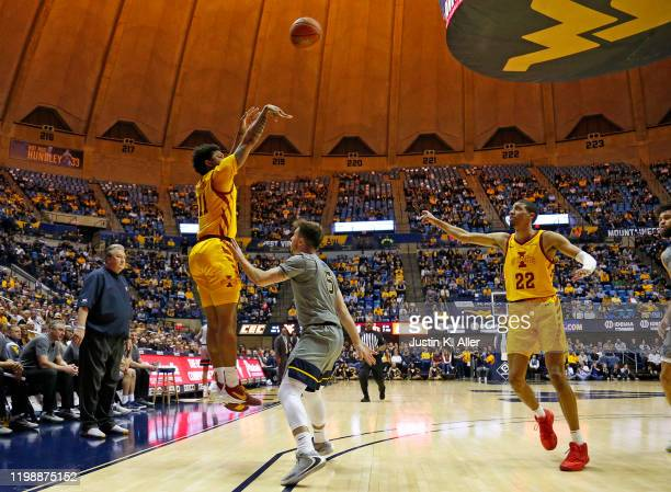 Prentiss Nixon of the Iowa State Cyclones pulls up for a three against Jordan McCabe of the West Virginia Mountaineers at the WVU Coliseum on...