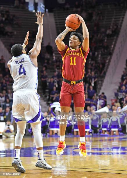 Prentiss Nixon of the Iowa State Cyclones puts up a shot against David Sloan of the Kansas State Wildcats during the first half at Bramlage Coliseum...