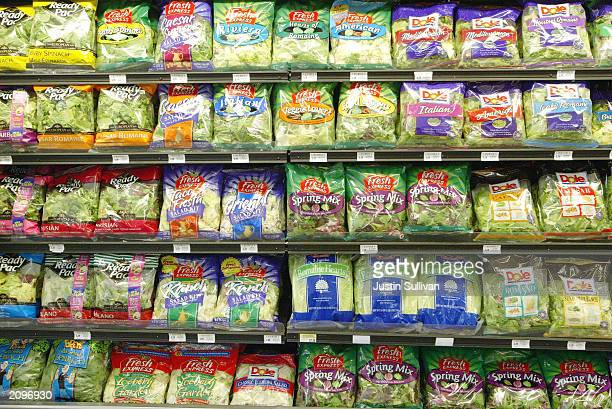 Pre-Packaged salad sits on the shelf at a Bell Market grocery store June 19, 2003 in San Francisco, California. Packaged salad which was near...
