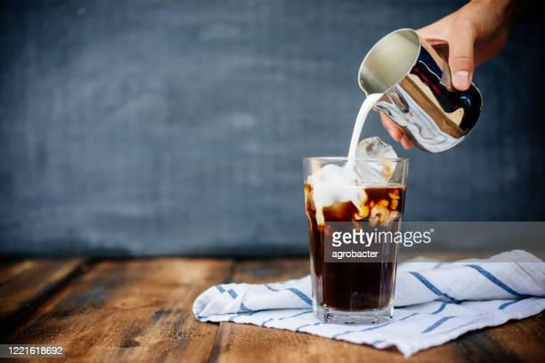 prepairing iced latte on wooden table - coffee crop stock pictures, royalty-free photos & images