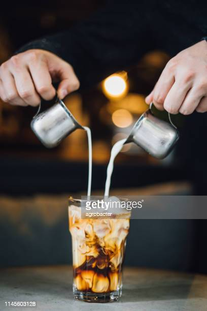 prepairing iced latte - icing stock pictures, royalty-free photos & images