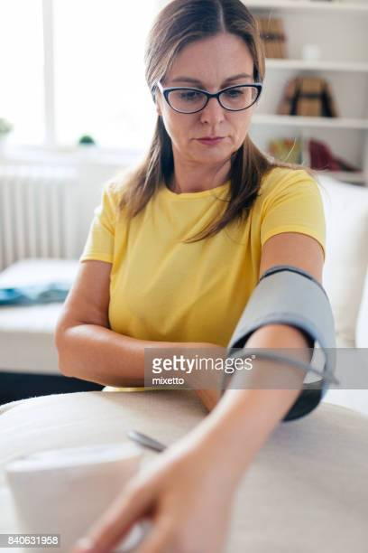 preparation checking blood presure - cardiovascular system stock photos and pictures