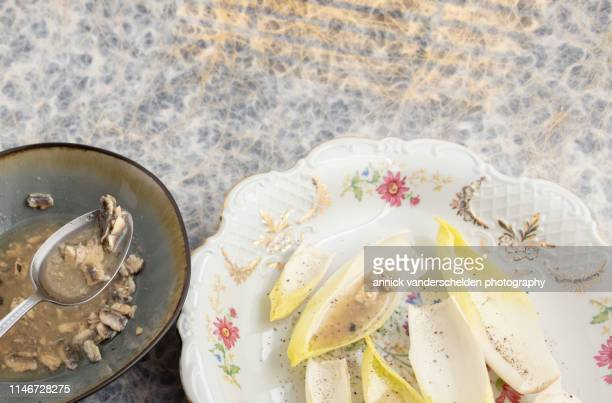 Preparation endive salad with anchovy dressing