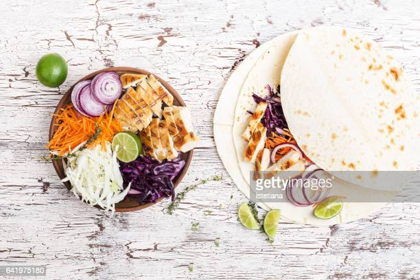 preparation flour tortilla wrap, ingredients for healthy mexican style snack - burrito stock pictures, royalty-free photos & images