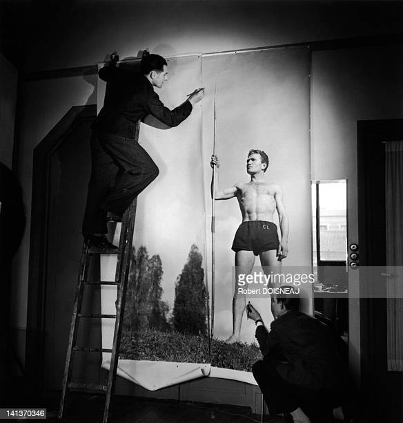 Preparation for a portrait session at the workshop of Robert Doisneau with Robert Cacheux circa 1945 France