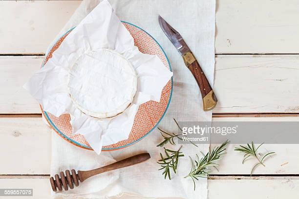 preparation for baked camembert - camembert stock photos and pictures