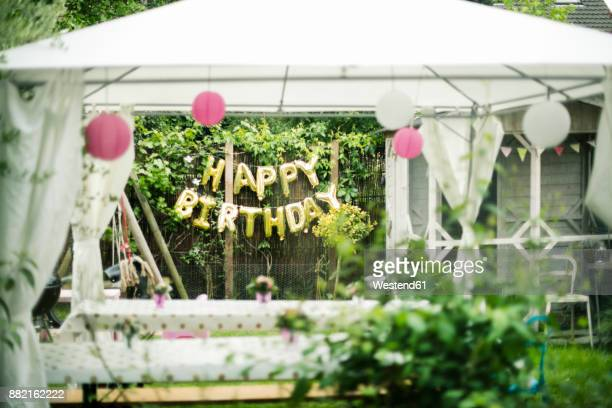 preparation for birthday party in the garden - birthday balloons stock photos and pictures