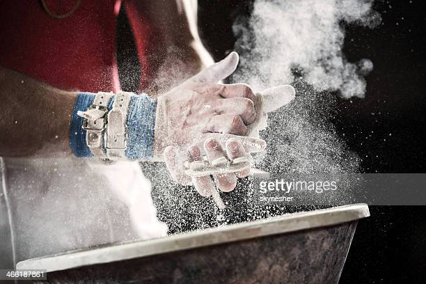 preparation for gymnastic bars. - gymnastics stock pictures, royalty-free photos & images