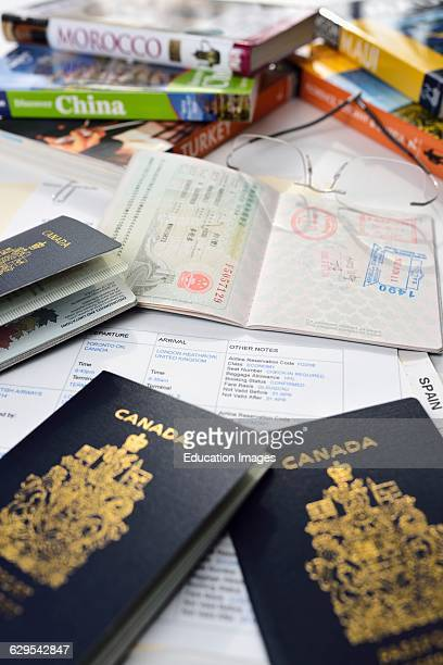 Preparation for holiday travel with guide books and flight itinerary and passports