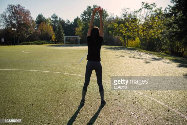 preparation for morning training in the park - lerexis stock pictures, royalty-free photos & images