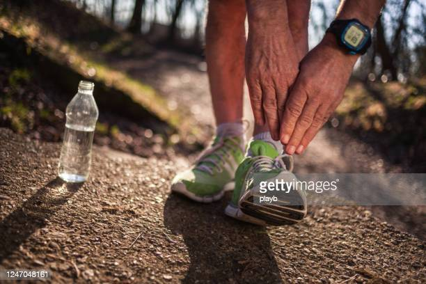 preparation for run - human leg stock pictures, royalty-free photos & images