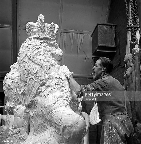 1953 Preparation for the Coronation of Queen Elizabeth II William Olds a moulter is pictured coating with plaster 'The Lion of England' one of the...