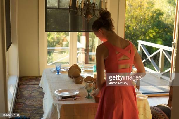 preparation of dinner - vestito arancione foto e immagini stock