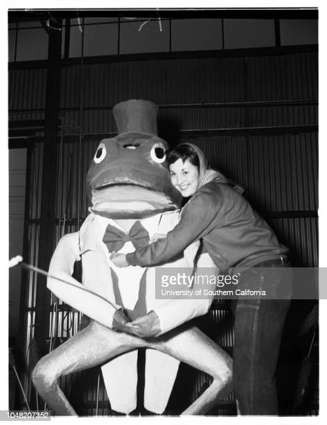Preparation of floats for Rose Parade 29 December 1951 Irving Yabner wiping off elephant on South Pasadena floatMoe Bear wiping off elephant on South...