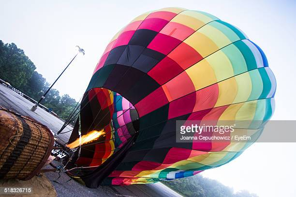 preparation of hot air balloon - inflating stock pictures, royalty-free photos & images