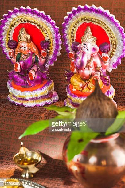 preparation of lakshmi pujan a hindu ritual during diwali festival - laxmi ganesh stock pictures, royalty-free photos & images