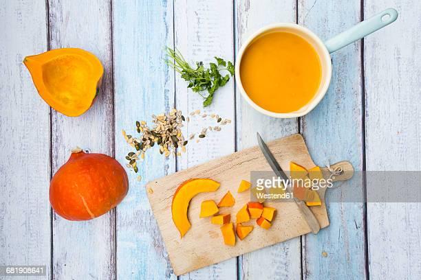 Preparation of organic pumpkin soup, chopped pieces on chopping board