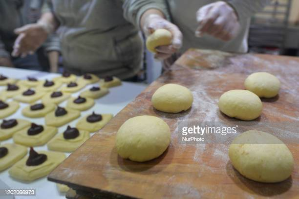 Preparation of Polish doughnuts at Krakow's 'Stara Piekarnia' bakery on Fat Thursday Every February Poland and Poles 'go nuts' for doughnuts on Fat...