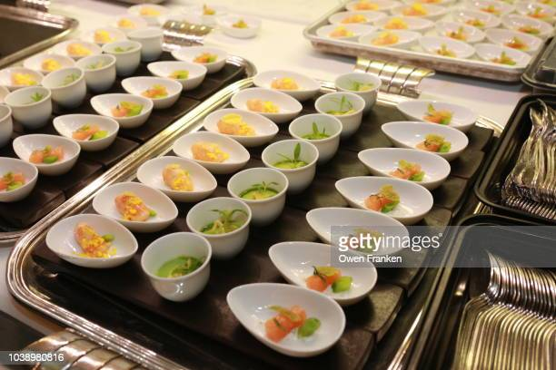 Preparation of seafood 'amuse bouche' small entrées in the kitchen of Restaurant Daniel