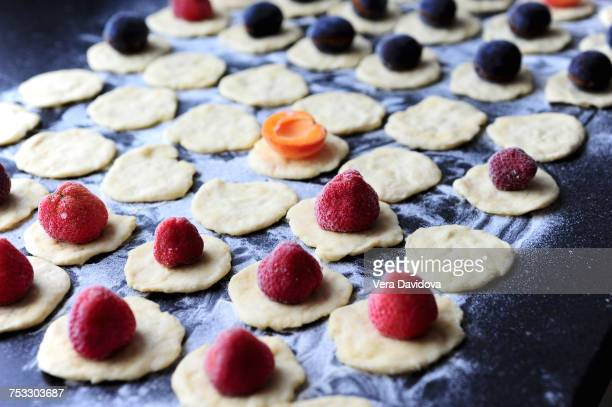 Preparation of strawberries, plums and apricots dumplings