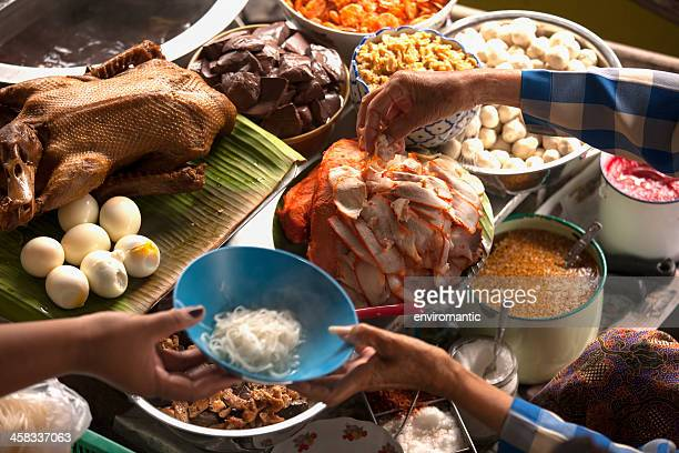preparation of thai noodle soup. - floating market stock photos and pictures