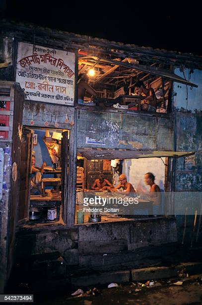 Preparation of the festival in the neighborhood of Kumartuli where 300 families of sculptors live Each year they make statues of the Goddess Durga to...