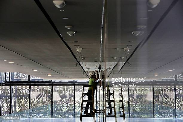 Preparation work continues inside the Smithsonian's National Museum of African American History and Culture during the press preview on the National...