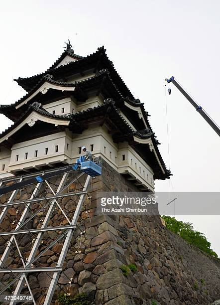 Preparation work for moving the Hirosaki Castle main tower begins on May 18 2015 in Hirosaki Aomori Japan The moving lifting the tower and move 70...