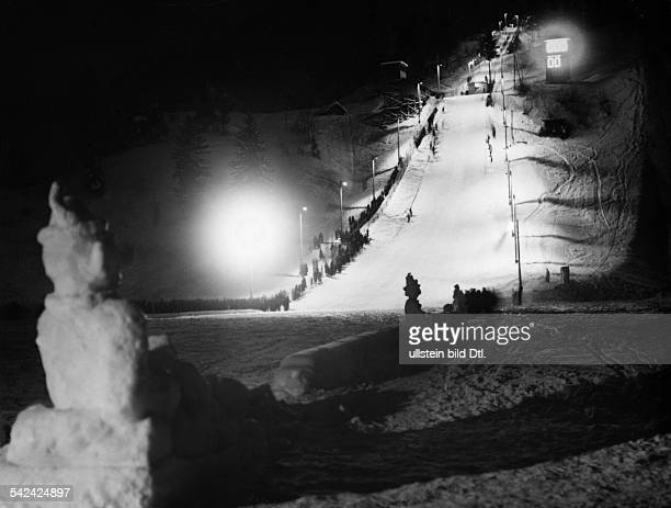 Preparation works for the Olympic Winter Games 1936: the first ski jumps on the by electronic lighting at the small Olympiaschanze Vintage property...