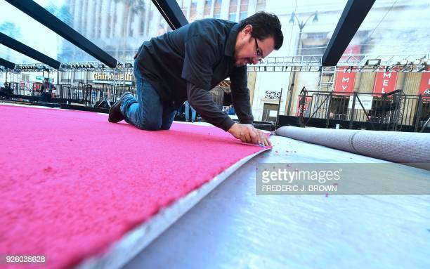 Preparations are underway on the red carpet in Hollywood California on March 1 2018 for the 90th Oscars on Sunday March 4 / AFP PHOTO / Frederic J...