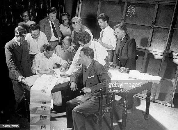 Preparations for filming Briefing discussion of the shooting with the storyboard ca 1932 Photographer Weltrundschau Erich ComerinerVintage property...